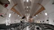 Loading cargo inside cargo airplane, Time Lapse