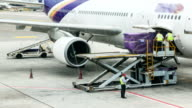 HD: Loading cargo to plane for air freight logistic background