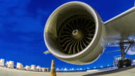 Loading cargo with jet turbine engine at twilight sky