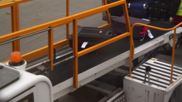 Loading luggage to aeroplane