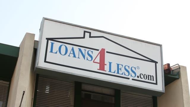 Loans4Lesscom advertises home mortgage loans Shots of the Loans4Lesscom sign Loans 4 Less Signage on September 10 2013 in Redondo Beach California