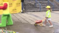 Local children unload 90000 Lego bricks on the site of the planned Legoland Discovery Centre near Arena Birmingham Interview with Amy Langham general...
