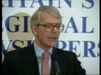 Party Press Conferences ENGLAND London Park Lane Hilton MS John Major from car and shakes hands with man PAN LR as both into bldg MS Major up to...