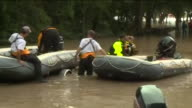 KIAH Local Fire and Rescue Workers Prepare Life Boats in Flood Water After Hurricane Harvey in Humble Texas on Aug 30 2017