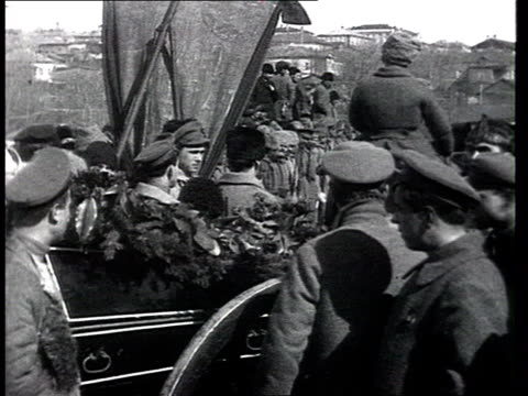 Local leader's burial in civil war period the commissar of the armoured train Mokiyevskaya Funeral cortege political leaders making speeches The Red...