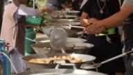 Local people cooking street food near Wat Pho, Bangkok, Thailand, Southeast Asia, Asia