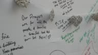 Locals add their messages to wall of condolence after Grenfell Tower fire
