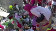 Locals and tourists leave flowers and messages at Barcelona's Plaza de Catalunya on Friday after attacks in Barcelona and Cambrils that left 14...