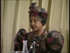 01 Location Unknown Winnie Mandela arriving at antiapartheid meeting with Adelaide Tambo wife of ANC ldr Oliver Tambo / Winnie onto stage to applause...
