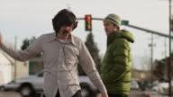 Lockdown shot of man listening to music and dancing in street / Orem, Utah, United States,