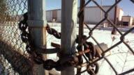 CU, Locked gate surrounding General Motors auto assembly plant, Lansing, Michigan, USA
