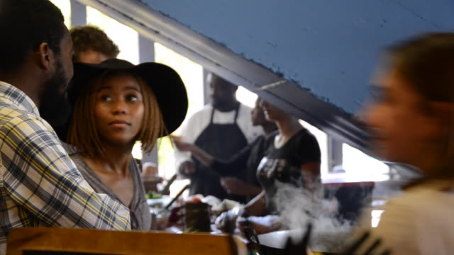 Locked off MS of African Ethnicity couple at popular food market/ Johannesburg/ South Africa