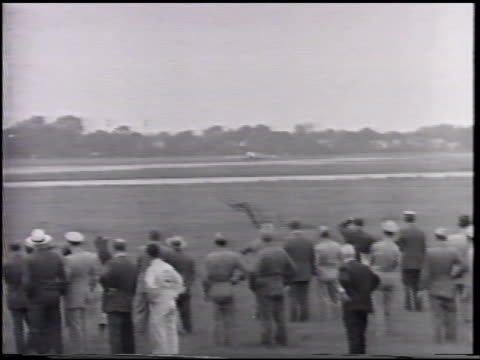 Lockheed P80 'Shooting Star' taxiing down frame TU Nose HA XWS P80 taking off from airstrip w/ men in suits military uniforms standing below FG...
