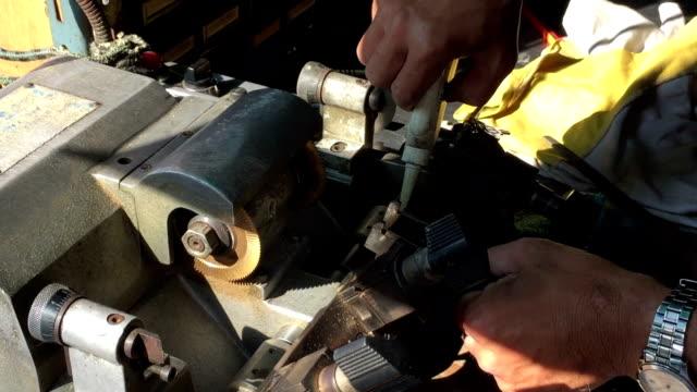 Locksmith making key by machine
