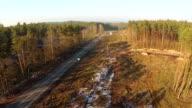 Logging clear cut and higway - Aerial shot.
