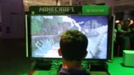 A logo for the Minecraft computer Xbox One video game produced by Mojang AB sits above a screen during the EGX gaming conference at Earls Court in...