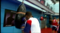 London 2012 Olympic Games legacy one year on Anthony Joshua T23111109 / TX Various of Anthony Joshua hitting punch bag in gym South Yorkshire...
