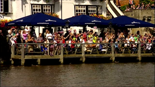 Medal winners perform row past on River Thames followed by a parade in Henley ENGLAND Oxfordshire Henley EXT Various rowers along River Thames Crowds...