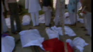 Meredith Alexander resigns from watchdog over Dow Chemical sponsorship LIB / TX INDIA Madhya Pradesh Bhopal EXT People stand looking at bodies on...