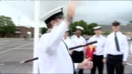 London 2012 Olympic Games Military personnel practise raising flags ENGLAND Hampshire Fareham HMS Collingwood EXT GVs Sailors folding flags / walk /...