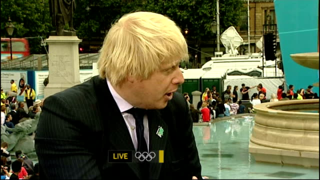 One year to go celebrations / Aquatics centre opens ENGLAND London Trafalgar Square EXT Boris Johnson LIVE interview SOT on findings of ComRes poll /...