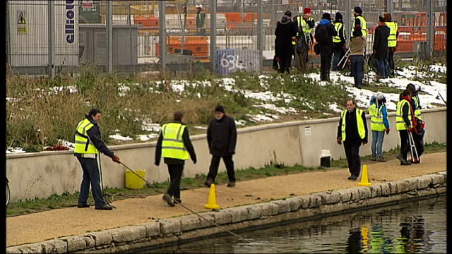 Organisers launch search for volunteers to clean London waterways ENGLAND London Hackney EXT Wide shot River Lea with Olympic Stadium in background...