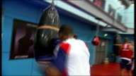 Profile on boxer Anthony Joshua T23111109 / TX ENGLAND London INT **Joshua interview overlaid SOT** Various of Anthony Joshua hitting punch bag in gym