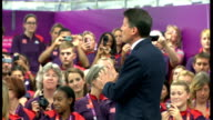 protests David Cameron meeting Olympic volunteers and heckled Games makers applauding arriving of Lord Coe on stage SOT David Cameron MP onto stage...