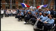 Paralympic cauldron lit in Belfast as Paralympic athletes arrive in London Various of French paralympic team singing french national anthem and...
