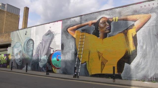 London artist Dreph creates large murals across city ENGLAND London Shoredithc EXT Shanley Blackman interview as looking at mural of herself SOT...