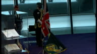 London Assembly Remembrance Day service French armed forces representative laying wreath / Man laying wreath / Johnson and others stood watching /...