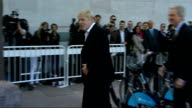 Boris Johnson and Marcus Agius photocall Boris Johnson along on bike hire bicycle and parking bicycle at docking station Boris Johnson speaking to...