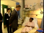 Queen and Prince Charles visit injured ENGLAND London Paddington St Mary's Hospital INT Prince Charles Prince of Wales as greets Cynthia BobbSemple...
