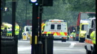 Ambulances arriving at King's Cross/ Jane Collins press conference ITN Audio track 1 FX / Audio track 2 FX ENGLAND London King's Cross EXT Ambulance...