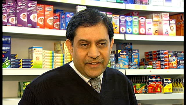 London boroughs to make contraceptive pill available without prescription Women behind counter in chemists one holding bottle Pharmacist looking at...