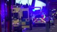 ITV News Special 0010 0050 London GIR Lucrezia Millarini and Rohit Kachroo London Bridge EXT / NIGHT People along as police vehicles flashing blue...