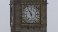Minute's silence across London ENGLAND London Westminster Bin Ben clock face at 11am Borough Market People observing minute's silence Police officers...