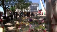 Police release details of weapons used London Bridge EXT People alongside makeshift memorial with floral tributes on ground Woman with head resting...