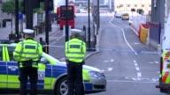 Southwark Street daytime scenes ENGLAND London London Bridge Southwark Street EXT Police officers in street / cordonedoff London Bridge / guests...