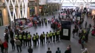 Third attacker and more victims named King's Cross St Pancras Staff and commuters standing for one minute silence Ambulance staff observing minute's...