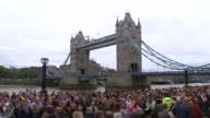 Vigil near Tower Bridge ENGLAND London City Hall EXT People gathered for vigil near Tower Bridge / people arriving / Justin Welby and other religious...