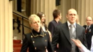 London Buckingham Palace EXT Zara Phillips out of palace with Tindall after being awarded an MBE Zara posing for photocall holding MBE with Tindall...