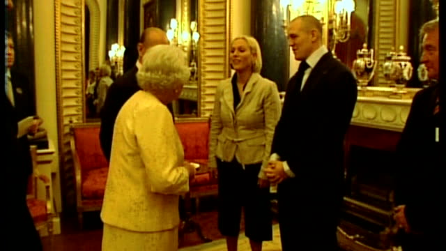 London Buckingham Palace INT Queen Elizabeth II and Prince Philip talking to Zara Phillips and Mike Tindall at Achievers' reception Phillips and...