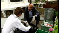 London councils conduct secret 'waste audits' on residents bins Hackney Tom McCourt interview SOT Close up of hands as putting on latex gloves ITN...