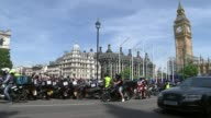 London delivery riders protest over acid attacks and moped thefts London EXT Various of scooter and motorcycle delivery drivers driving into...
