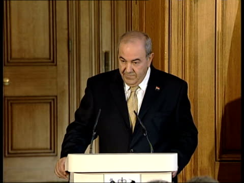 London Downing Street Number 10 Iraqi Prime Minister Iyad Allawi press conference SOT we are succeeding against the forces of evil I am really...
