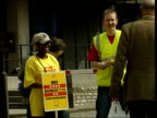 London EXT 'Don't pay for Shell suits' placard held by protestor Shell employees protesting at bonus given to executives 'Why give the bosses a...