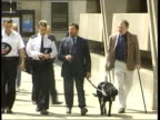 EXT Home Secretary David Blunkett MP along with guide dog Lucy and police officers