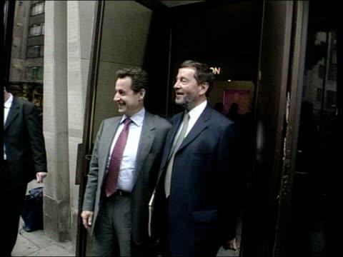London EXT Home Secretary David Blunkett posing for photocall with French Interior Minister Nicolas Sarkozy TILT DOWN as Sarkozy pets guide dog