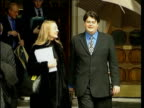 London EXT LMS David Shayler towards from court with girlfriend as umbrella held above PULL OUT David Shayler speaking to press SOT Implications of...